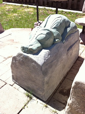 Dragon sleeping on a rock garden statue